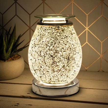 A beautifully decorated Desire Aroma Lamp with a crackled Mosaic effect with a Silver glowing hue