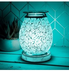 A beautifully decorated Desire Aroma Lamp with a crackled Mosaic effect with a Blue glowing hue