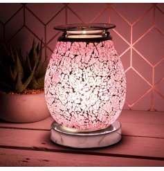 A beautifully decorated Desire Aroma Lamp with a crackled Mosaic effect with a Pink glowing hue