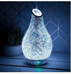 A gorgeously decorated Silver Mosaic Humidifying Lamp with an added LED Aroma Bulb inside