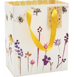 Sure to add a smile to any recipients face, this beautifully patterned gift bag is from the popular Busy Bee Range