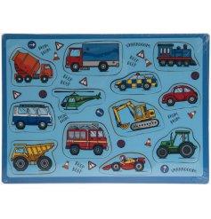 A wooden puzzle with multiple vehicles including tractors, diggers and emergency vehicles.