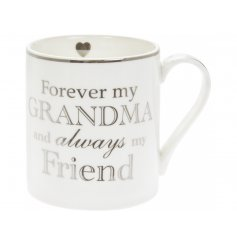 A Fine China Mug featuring a sweetly scripted silver text decal on it   Perfect for gift giving to any loved Grandma