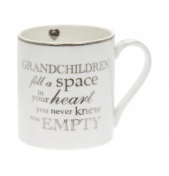 A sweetly scripted fine china mug with an added silver decal