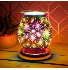 An attractive melt and oil burner lamp with a striking 3D fireworks design.