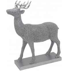 Bring a glitzy vibe to any home space with this sleek and stylish ornamental stag statue covered with blingy diamonte a