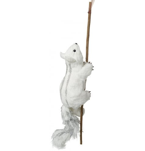 A winter woodland squirrel decoration with branch. Complete with silver tipped bushy tail and back.