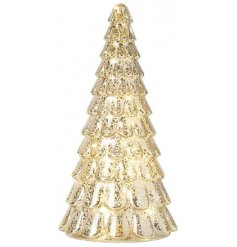 Sure to bring a Luxe feel to any home at Christmas, this warm glowing LED Tree features a gold mottle effect