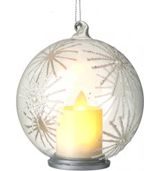 A glass bauble covered with a glittery snowflake decal , perfectly complete with a flickering LED candle centre