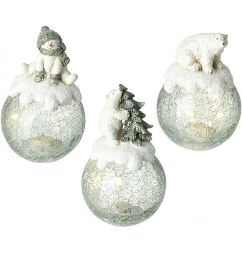 Crackled glass LED globes with charming snowman and polar bear ornaments.