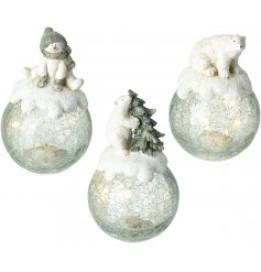 A cute mix of festive themed glass baubles each with added led centres and cute snowman and bear topped decals