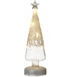 A tall standing glass tree ornament set with a warm glowing LED Centre and added glitzy topped finish