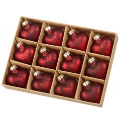 Set with a deep red mottled tone, a set of 12 glass heart baubles