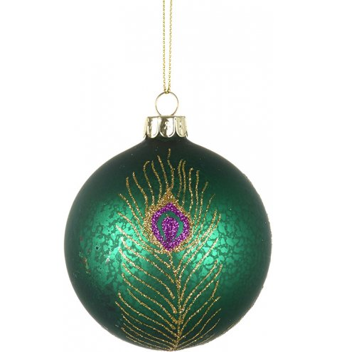 A luxury green bauble with an antique, mottled finish. Decorated with a colourful glitter peacock feather design.