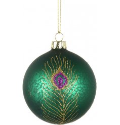 A gorgeous mottled green glass bauble decorated with a glittery silver peacock feather design