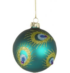 A sleek and stylish glass bauble with a glittery peacock feather decal