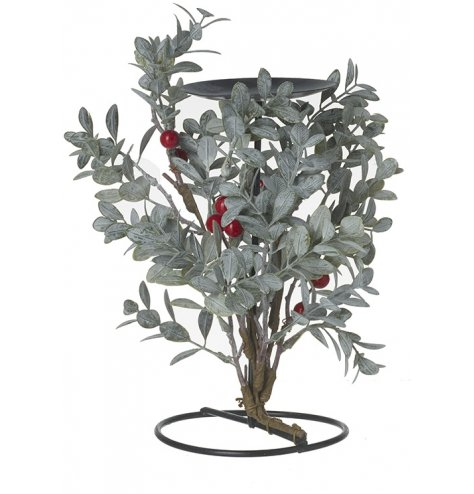 A beautiful black metal pillar candle holder adorned with climbing natural foliage and red berries.