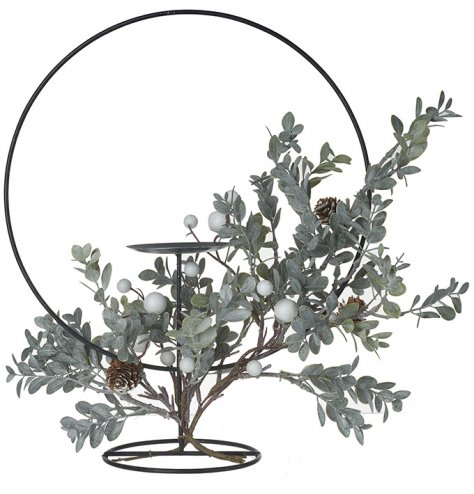 A chic and super stylish black metal pillar candle holder with an attractive hoop.