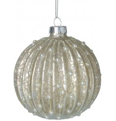 Decorated with a beautiful mottled effect, this champagne glass bauble also features a glittery decal