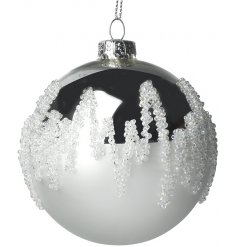 A gorgeous silver mirrored glass bauble with added white beaded touches