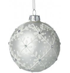 A beautifully frosted white glass bauble with an added flower decal and diamonte finish