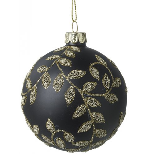 An elegant and ornate black bauble with a swirling gold glitter leaf design.