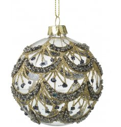 A beautiful clear glass bauble decorated with a gold and black toned glitzy bead pattern
