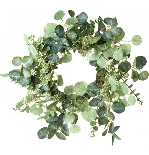 A full eucalyptus and mixed foliage wreath with white berries.