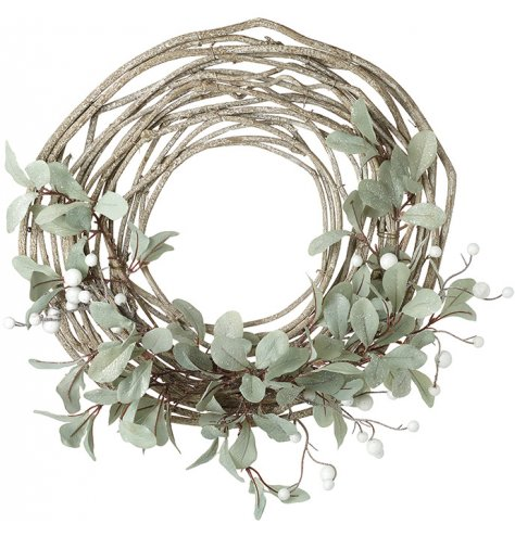 A stylish woven twig wreath with a half finished design , covered with a green leaf and white berry decal