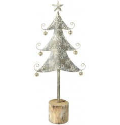 A tall standing metal tree decoration with jingle bell baubles and a pretty snowflake design