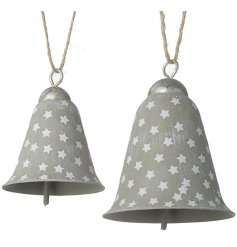 A set of Distressed whitewashed metal bell decorations set with an added star design