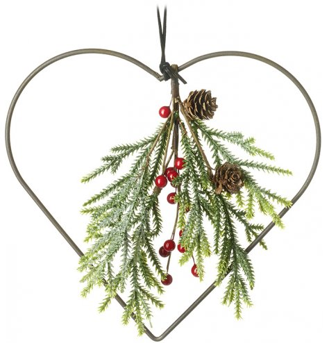 A chic metal heart wreath with an attractive foliage bunch including red berries and pinecones.