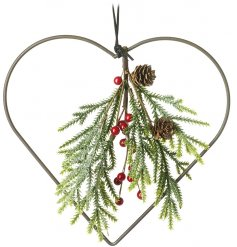 A simple hanging metal heart with a beautiful Woodland Foliage Branch set in the centre