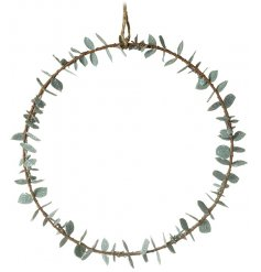 A simple round wreath with a Eucalyptus leaf entwined around it