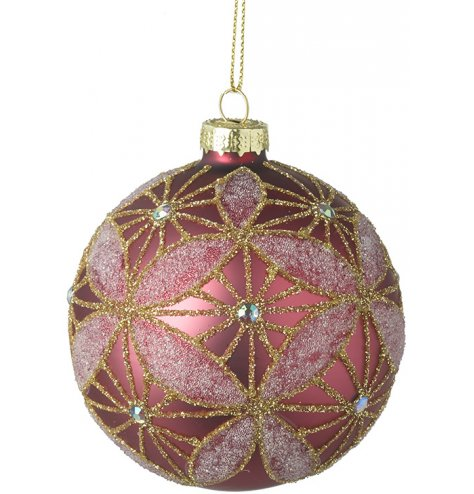 A stunning pink bauble, decorated with an ornate gold and pink glitter pattern. Complete with sequins.