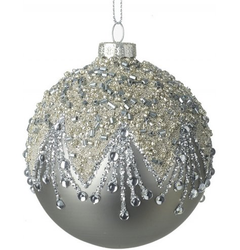 A stunning silver glass bauble with an ornate cascading design featuring sequins, glitter and beads in a chandelier drop