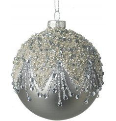A gorgeous matte grey glass bauble decorated with a silver and glitter pattern