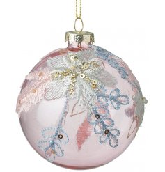 A beautiful opaque pink glass bauble decorated with an embroidery inspired floral print