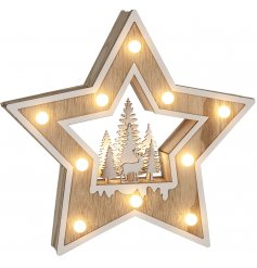 A beautifully detailed natural wooden star surrounded with white trimmings, fitted LED lights and a woodland scene cent