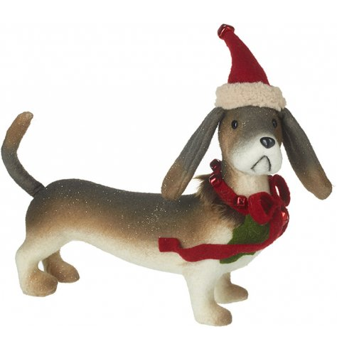 A luxurious and totally fabulous sausage dog decoration complete with Santa hat and a bell adorned collar.