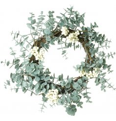 A round eucalyptus wreath with added white berries
