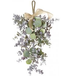 A gorgeous alternative to hanging mistletoe in the home, a beautiful Eucalyptus branch with a jute bow