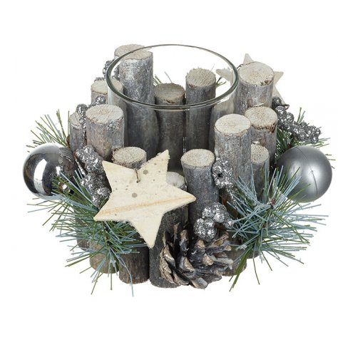 A wonderfully decorated glass t-light holder with natural bard, artificial foliage, pinecones and silver baubles.