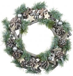 A round wreath built up of pine needles, twigs, stars and baubles