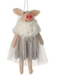 A hanging woollen pig dressed up in a sparkly grey skirt and faux fur collar