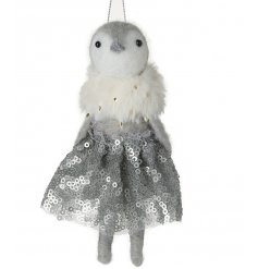 A charming hanging woollen penguin with a sequin skirt and faux fur collar