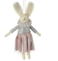 A hanging felt bunny dressed up in a sparkly pink skirt and faux fur collar