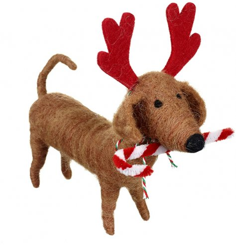 A charming felt sausage dog dressed up as a reindeer. Complete with a festive candy cane.