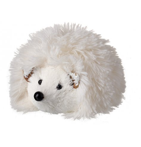 A fluffy faux fur hedgehog decoration with snow frosted ears