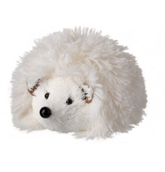 An adorable fuzzy hedgehog decoration with added snow covered ears